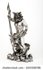 decorative figure of god Zeus is holding lightning on white background