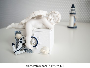 decorative figure of a sleeping angel on the coffer