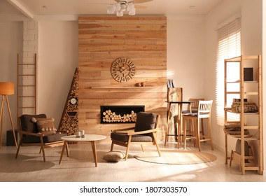 Decorative fireplace with stacked wood in cozy living room interior