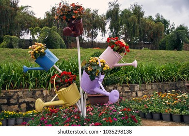 Decorative flower bed in the form of a watering can