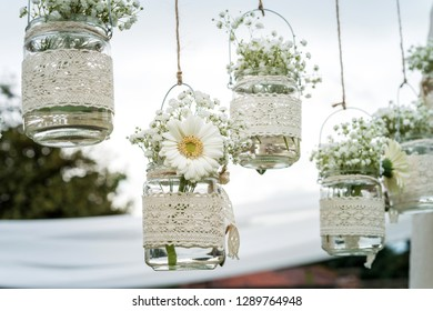 Decorative flowers in bulbs hung in a wedding party