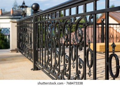 Decorative, forged banisters, fence in old style