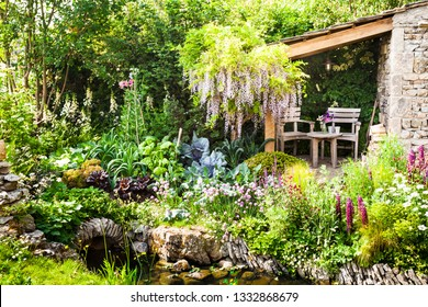 Decorative garden with a patio area in a countryside