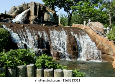 Decorative garden waterfall with a blue sky background