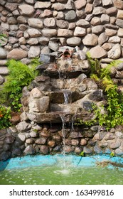 Decorative garden waterfall and pond made of stone