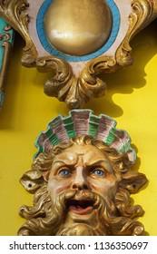 Decorative gargoyle on carousel