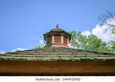 Decorative Gazebo central hub cap. Gazebo roof and shingles. Outdoor structure.