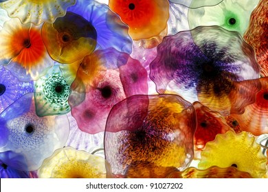 Decorative glass flowers illuminated to provide a special glow