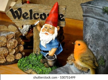 """Decorative gnome with sign """"Welcome""""."""