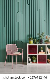 Decorative green wall chair and white bookshelf style in the room.