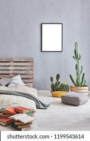 Decorative grey bed room and wooden pallet bed. Many pillow frame and white lamp concept. vase of green plant.