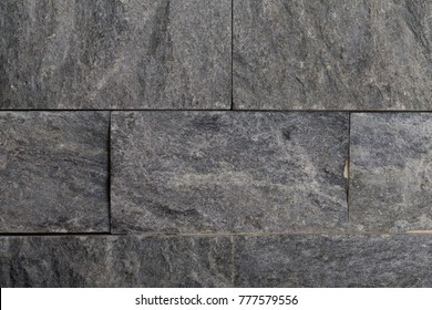 Decorative grey stone wall texture for background.
