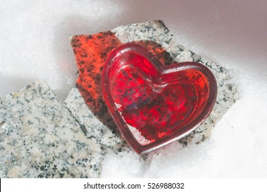 a decorative heart on a stone in winter