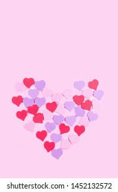 decorative hearts on a pink background, copy space, top view, mockup, valentines day concept, invitation card for wedding, love, romance, postcard