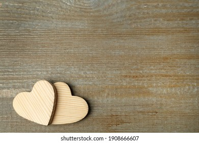 Decorative hearts and space for text on wooden table, flat lay. Valentine's Day