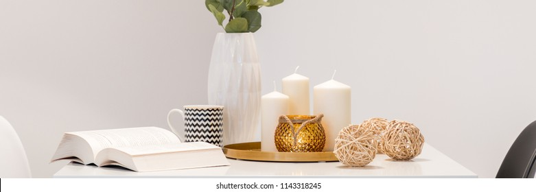 Decorative home accessories in scandinavian style lying on white table, panorama