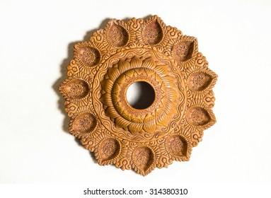 A decorative indian terra-cotta lamp. A craft.