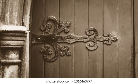 Decorative Ironwork on Wooden Door in Sepia Tone, Shallow Depth of Field Horizontal Photography