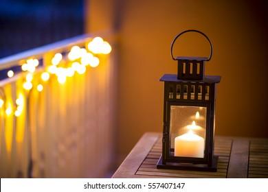 Decorative lanterns lit on the table.