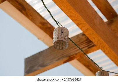 Decorative light shade and wooden beams