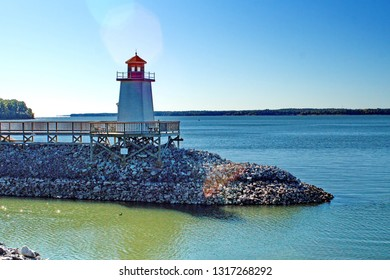 Decorative lighthouse at the end of a jetty in the Ohio River, Paducah, Kentucky, USA