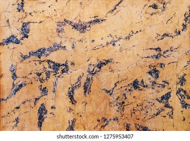 Decorative marble with limestone elements, old wall of the 19th century. Abstract marble stone texture for background or interiors design.