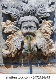 A decorative medallion, with a face & acanthus leaves, surround the spigot of a drinking water fountain, in the old city of Dubrovnik, Croatia