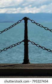 Decorative metal dock fence with the Tasman Sea in the background.