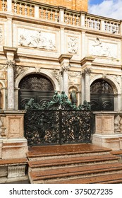 Decorative metal gate ornament. Antique iron door with classic ornaments of Campanile in Doge's palace, Venice, Italy