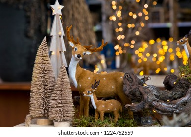 Decorative miniature reindeer and christmas trees