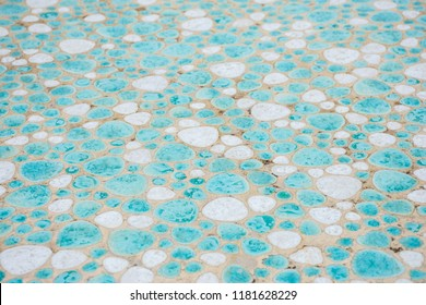 Decorative mosaic made of smooth stones for the floor as a beautiful background