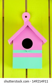 Decorative nesting box on color wooden background