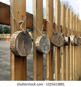 Decorative numbers on a wooden schoolyard fence