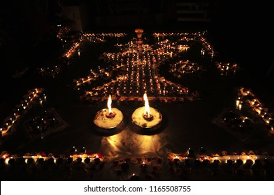 Decorative oil or wax burning traditional Diwali Diya or lamps arranged with shiva linga in a shape of symbolic Hindu lord Shiva's trishul (trident) and damru (instrument). Ideal Diwali greeting cards