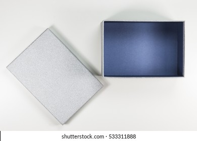 Decorative Open Small Flat Silver Box with Blue Inside on White Background.   Top View.