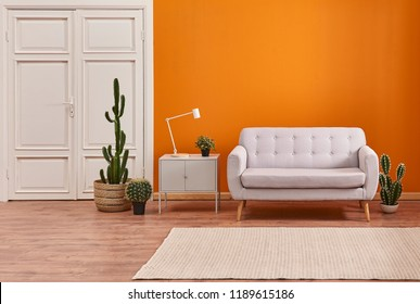 Decorative orange background wall white classic door and carpet decor.