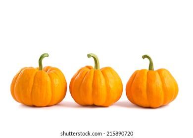 Decorative orange pumpkins, isolated on white background