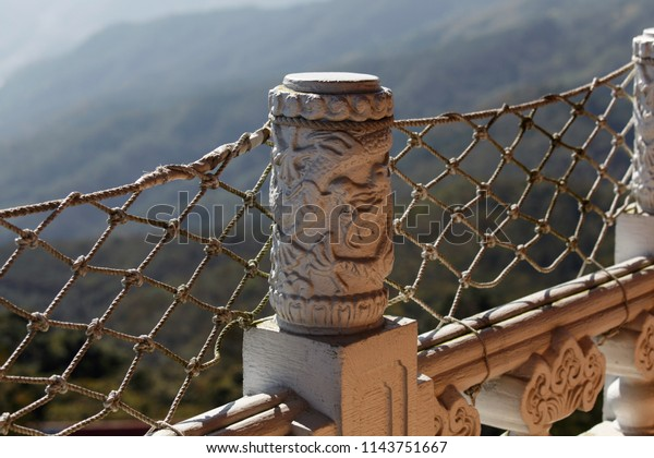 Decorative Ornamental Stone Post Rope Fencing Stock Photo