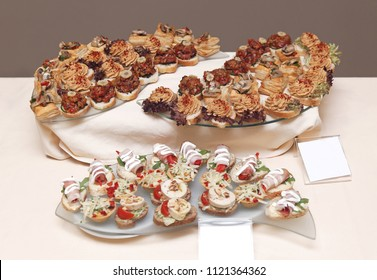 Decorative party food appetizers on table