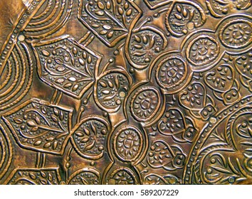 The decorative pattern on the old shabby gold