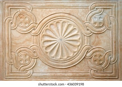Decorative pattern on a sandstone slab, background, texture