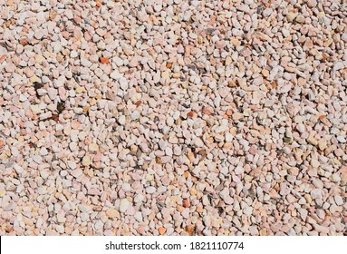 Decorative pebble stone background beige to pink colors garden ground cover
