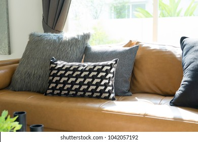 decorative pillow on leather sofa in living room