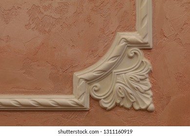 Decorative plaster moldings on the wall