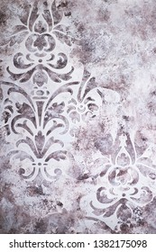 decorative plaster with ornaments. concrete background texture damask