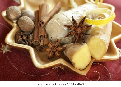 Decorative plate with ginger, lemon peel, anise, clove, nutmeg and cinnamon sticks.