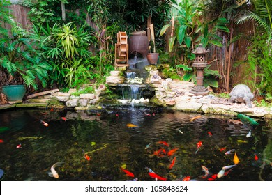 Decorative pond with fountain and gold fish