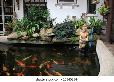 Decorative pond with gold fish in luxury garden home
