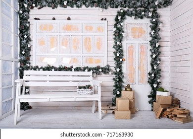 Decorative porch with Christmas decoration in white tones with a garland
