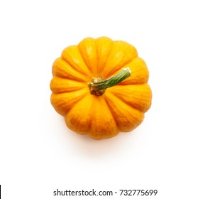 Decorative pumpkin isolated on white background. Top view.